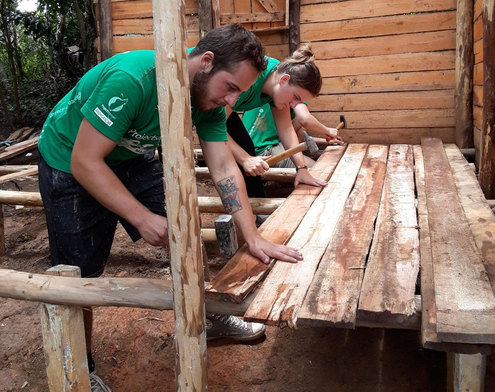 Volunteers helping to build new accommodation for the community in Madagascar